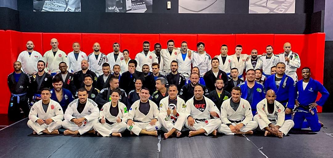 Two coaches practice brazilian jiu-jitsu